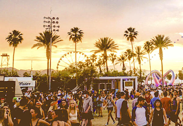 music festival fairground with people walking and talking, with a sunset and palm trees and a Ferris wheel