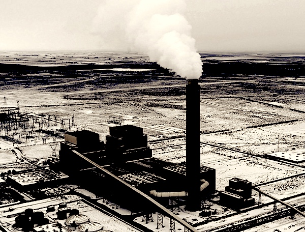 An aerial view of the Intermountain Coal-Fired Power Plant, with hot carbon smoke blasting out of its 700 foot tall smokestack.