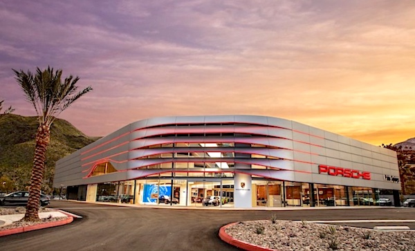 The Porsche dealership in Palm Springs looks like a sleek spaceship just landing in the a desert sunset. Photo.