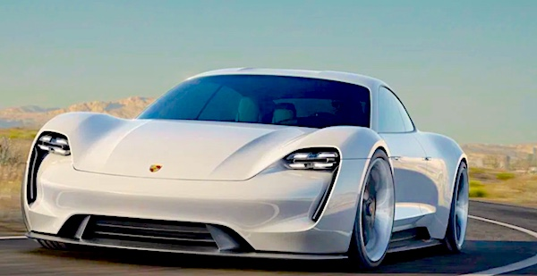 An electric sports car looks aerodynamic while speeding down a desert highway. Photo.