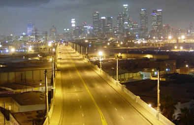 LA's 415 freeway at night with its streetlights casting a yellow hue.